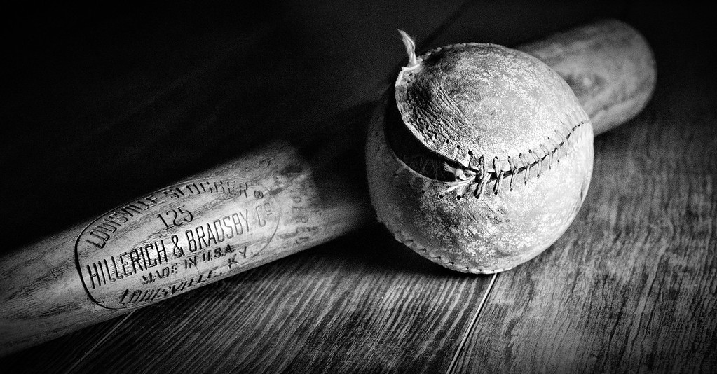 """Feb 10 - The Old Louisville Slugger<br /> <br /> This wooden bat and ball also belonged to my husband's dad when he was young. <br /> <br /> I haven't been able to comment much but was able to yesterday.  From other's comments, I see that there is a """"still life"""" challenge for Sundays images.  I usually don't post on weekends and took this image before I knew about the challenge.  So, I am posting this today and will probably post another still life tomorrow.  I am learning and playing with light set up as well.<br /> <br /> Thanks for your comments on my rose pedal image I posted yesterday."""