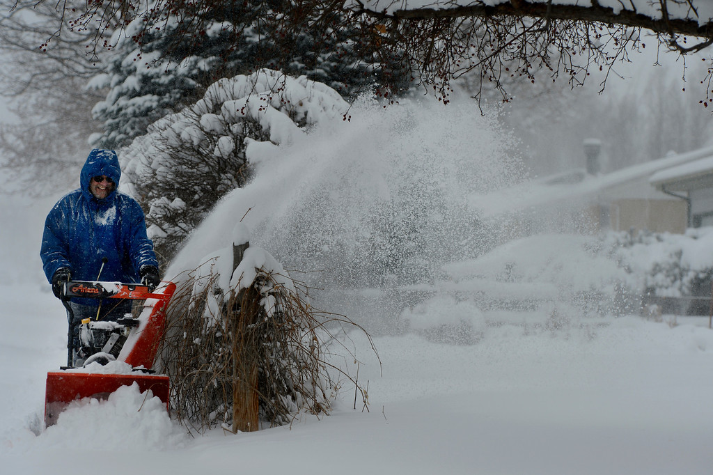 . LITTLETON, CO. - MARCH 23: Jack Cusick clears a neighbors sidewalk  in Littleton, CO March 23, 2013. Cusick said he usually clears the walk for 20 of his neighbors and he has been through 3 snowblower in the past 10 years.The Saturday forecast calls for snow accumulation of 9 to 12 inches with highs in the lower to mid 20s. (Photo By Craig F. Walker/The Denver Post)