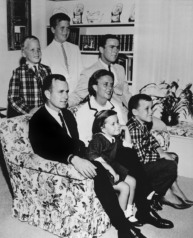 . FILE - In this 1964 file photo, George H.W. Bush sits on couch with his wife Barbara and their children. George W. Bush sits at right behind his mother. Behind couch are Neil and Jeb Bush. Sitting with parents are Dorothy and Marvin Bush.  Again? Really? There are more than 300 million people in America, yet the same two families keep popping up when it comes to picking a president. The possibility of a Bush-Clinton matchup in 2016 is increasingly plausible. After months of hints and speculation, former Florida Gov. Jeb Bush last week said he\'s actively exploring a bid for the Republican nomination. And while Hillary Rodham Clinton hasn\'t revealed her intentions, she\'s seen as the odds-on favorite for the Democratic nomination. By Nancy Benac. ? (AP Photo, File)
