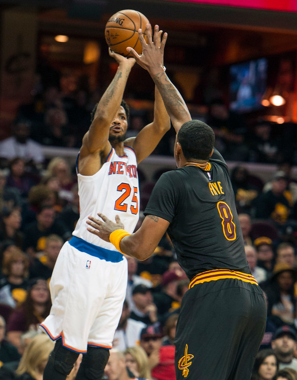 . New York Knicks\' Derrick Rose (25) shoots over Cleveland Cavaliers\' Channing Frye (8) during the second half of an NBA basketball game in Cleveland, Tuesday, Oct. 25, 2016. (AP Photo/Phil Long)