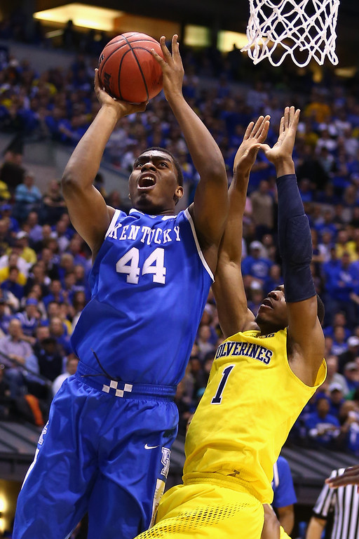 . Dakari Johnson #44 of the Kentucky Wildcats shoots the ball over Glenn Robinson III #1 of the Michigan Wolverines during the midwest regional final of the 2014 NCAA Men\'s Basketball Tournament at Lucas Oil Stadium on March 30, 2014 in Indianapolis, Indiana.  (Photo by Andy Lyons/Getty Images)