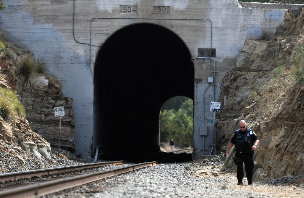 . A pedestrian was struck and killed by an Amtrak train in Chatsworth at the Topanga Canyon Blvd. tunnel Friday morning.  It happened about 9 a.m., when a man in his 60s was near the entrance of a train tunnel below the Santa Susana Pass on April 4, 2014. Investigators survey the scene.  (Photo by Dean Musgrove/Los Angeles Daily News)