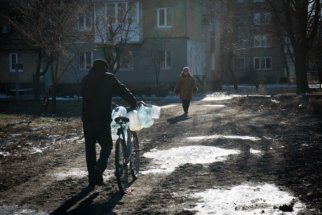 . A man pushes a bicycle loaded with empty plastic bottles as he goes to fetch water from a tank in Donetsk on February 17, 2015. The European Union on February 17, 2015 called for the immediate pull-back of heavy weapons from the frontline in eastern Ukraine and voiced concern about the surge in fighting in a key flashpoint town of Debaltseve. ANDREY BORODULIN/AFP/Getty Images