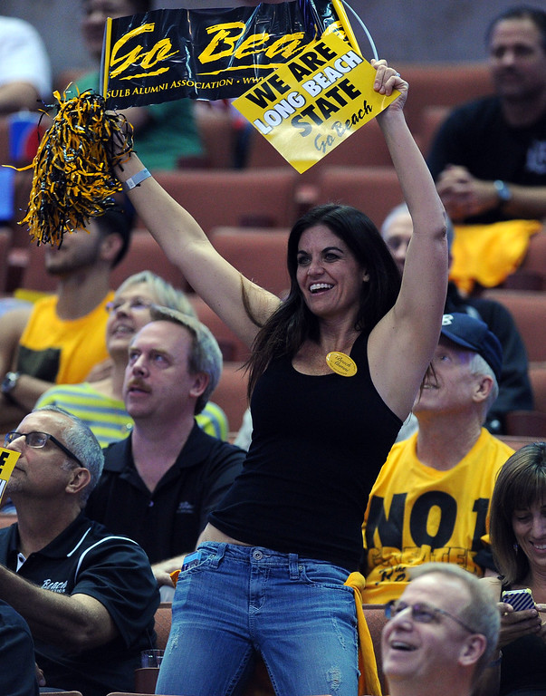 . A LBSU fan cheers on the 49ers at the Honda Center in Anaheim, CA on Thursday, March 13, 2014. Long Beach State vs CSU Fullerton in the Big West men\'s basketball tournament. 2nd half. LBSU won 66-56.  Photo by Scott Varley, Daily Breeze)