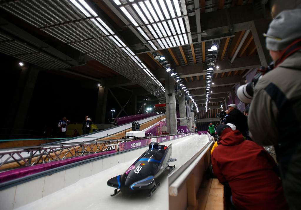 . A German team heads out of the starting area for the Two-man Bobsleigh at the Sanki Sliding Center for the 2014 Winter Olympics in Krasnaya Polyana, Russia, on Sunday, Feb. 16, 2014.  (Nhat V. Meyer/Bay Area News Group)