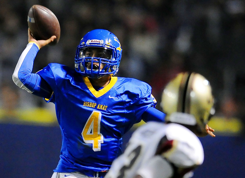 . Bishop Amat quarterback Koa Haynes (C) (4) passes in the first half of a prep football game against Alemany at Bishop Amat High School in La Puente, Calif., on Friday, Oct. 25, 2013.    (Keith Birmingham Pasadena Star-News)