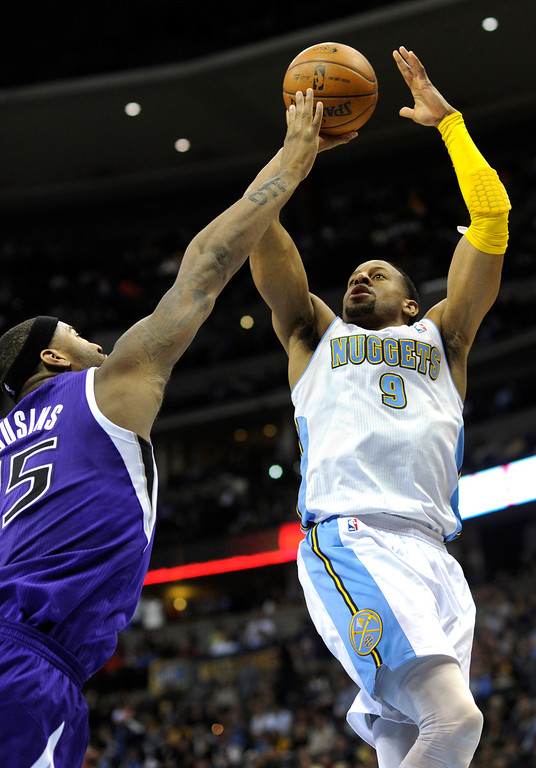 . DENVER, CO. - MARCH 22: Andre Iguodala (9) of the Denver Nuggets launched a shot over DeMarcus Cousins (15) of the Sacramento Kings in the second half. The Denver Nuggets defeated the Sacramento Kings 101-95 Saturday night, March 23, 2013 at the Pepsi Center. The Nuggets extended its longest winning streak since joining the NBA to 15 games with the win over the Kings. (Photo By Karl Gehring/The Denver Post)