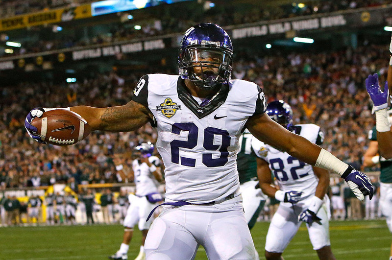 . TCU running back Matthew Tucker (29) celebrates his touchdown behind Michigan State cornerback Trae Waynes (15) during the first quarter of the Buffalo Wild Wings Bowl NCAA college football game, Saturday, Dec. 29, 2012 in Tempe, Ariz. (AP Photo/The Arizona Republic, David Kadlubowski)
