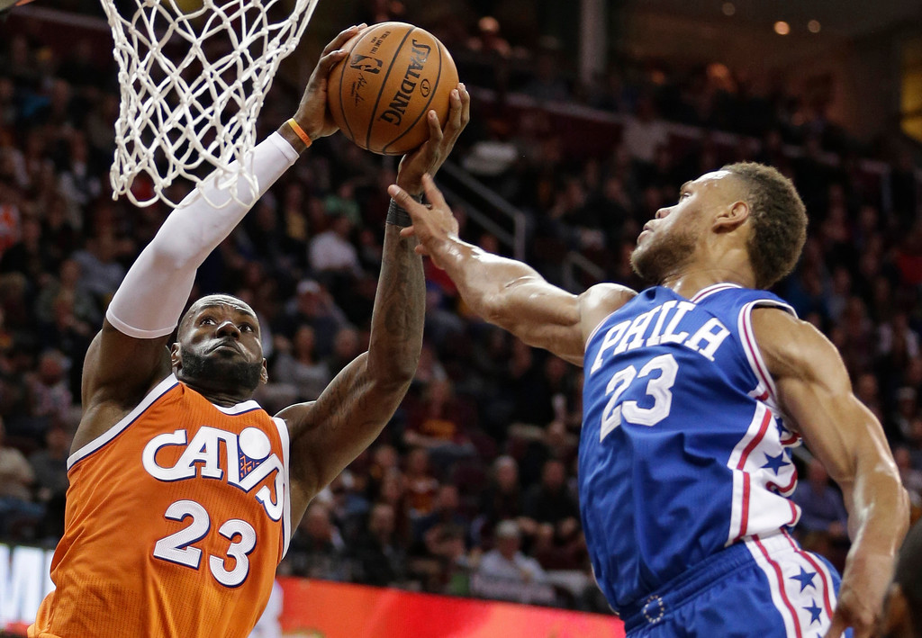 . Cleveland Cavaliers\' LeBron James, left, drives to the basket against Philadelphia 76ers\' Justin Anderson in the first half of an NBA basketball game, Friday, March 31, 2017, in Cleveland. (AP Photo/Tony Dejak)