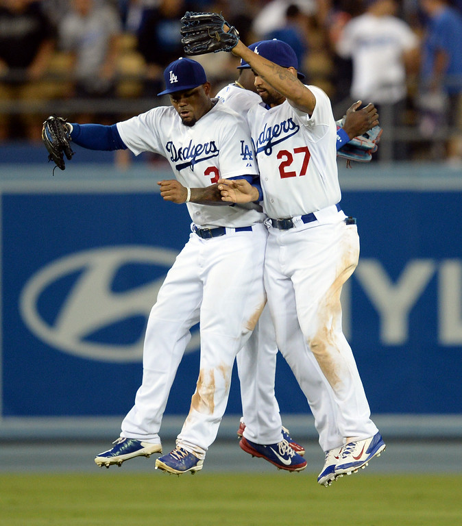 . Dodger outfielders Carl Crawford #3, Yasiel Puig #66 and Matt Kemp #27 celebrate their win over the Padres at Dodger Stadium Thursday, August 21, 2014. The Dodgrs beat the Padres 2-1. (Photo by Hans Gutknecht/Los Angeles Daily News)