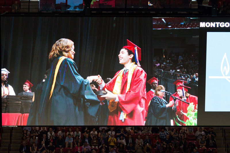 Noah shakes hands with Principal Renay Johnson (as seen on jumbotron imonitor) -- Noah Friedlander - June 6, 2017 graduation from Montgomery Blair High School - Magnet Program for Math, Science, and Computer Science, Xfinity Center, University of Maryland, College Park.