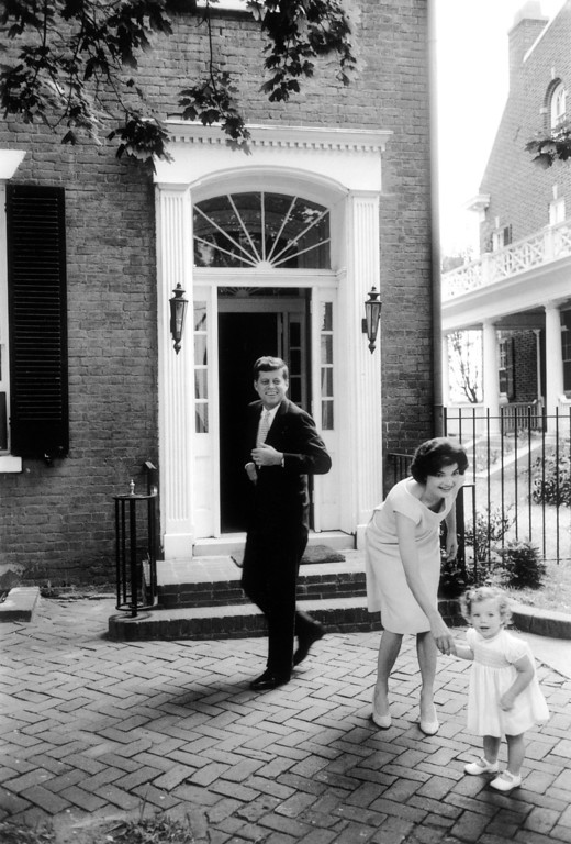 . Senator and Mrs. John F. Kennedy with daughter Caroline outside their townhouse.  Georgetown, 1959.   Los Angeles Daily News file photo