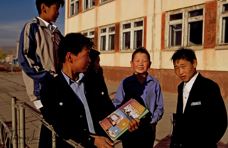 "These school boys are studying in class nine at Sarangol town locate 250 KLMs northwest of Ulaan Batar. Sarangol was a mining town before the soviets left Mongolia in 1994. Sarangol was one of the largest coal and gold mines in Mongolia. It is now shut down except for the Ninjas whose income comes from the specks of gold clawed from the river bed. If history is truth then these boys upon graduation will take up private mining, it is in their blood stream. Several ninjas upon being asked how much money they make a month, commented in their old jobs as herders they were self-sufficient in food and dairy products, and now they can make nearly $500  a month mining for gold. The golbal price of gold is risen 25 % this year to US$ 650 an ounce. When asked what they will do after graduating from school, they commented ""of course we will become private miners. The monthly income is nearly 5 times more than what are school teachers make i.e. USD52."""