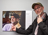 SPG photographer Mike cullen with his portrait in the Ellen Jacob show