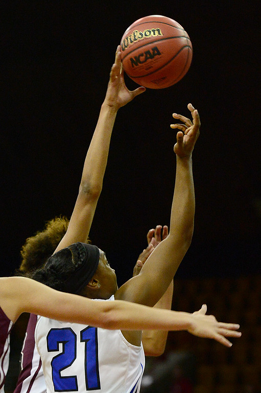 . Horizon guard Isabella Allen (23) blocks the shot of Highlands Ranch guard Symone Starks during the first quarter at the Pepsi Center on March 4, 2016 in Denver, Colorado. Highlands Ranch defeated Horizon 65-35 to advance to the semifinals of girls 5A basketball tournament. (Photo by Brent Lewis/The Denver Post)