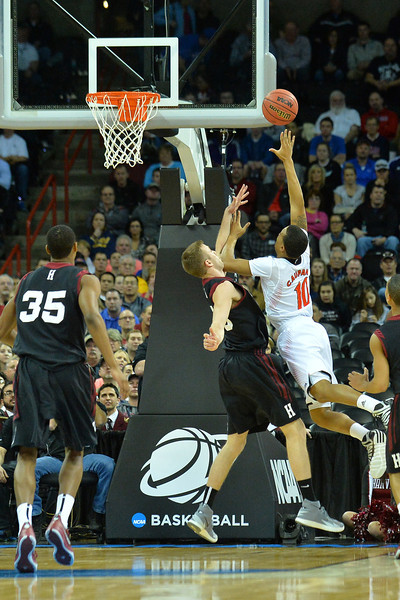 March 20, 2014: Cincinnati Bearcats guard Troy Caupain (10) puts up a shot during a second round game of the NCAA Division I Men's Basketball Championship between the 5-seed Cincinnati Bearcats and the 12-seed Harvard Crimson at Spokane Arena in Spokane, Wash. Harvard defeated Cincinnati 61-57.