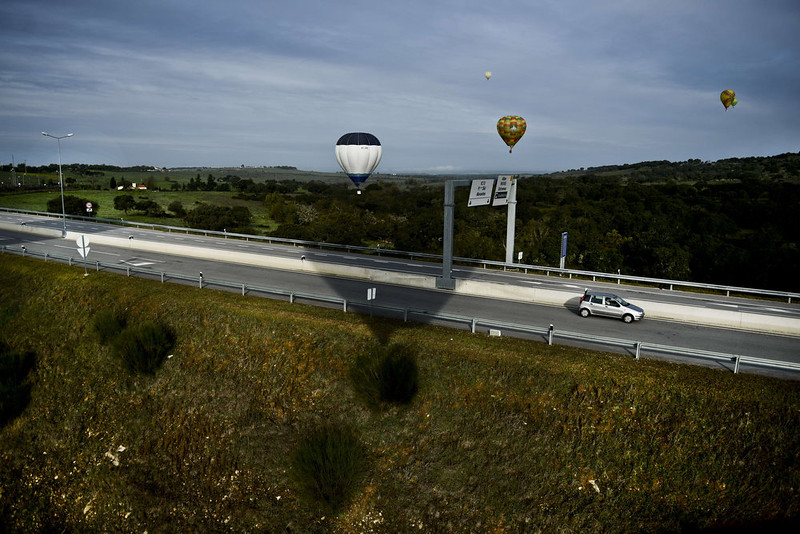 . Balloons fly over a road during the 18th International Festival of Hot Air Balloons in Alter do Chao in the center of Portugal on November 10 2014. PATRICIA DE MELO MOREIRA/AFP/Getty Images