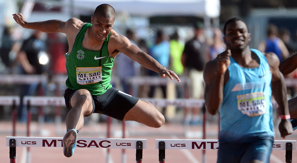 . Ashton Eaton, left, competes in the 400 meter hurdles Invitational elite during the Mt. SAC Relays in Hilmer Lodge Stadium on the campus of Mt. San Antonio College in Walnut, Calif., on Saturday, April 19, 2014. 
