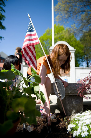 Girl Scouts plant flowers