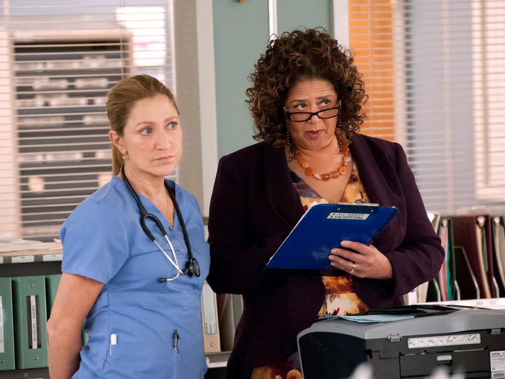 """. In this image released by Showtime, Edie Falco, left, and Anna Deavere Smith appear in a scene from \""""Nurse Jackie.\"""" Falco was nominated for a Golden Globe for best actress in a comedy series for her role on the show on Thursday, Dec. 11, 2014. The 72nd annual Golden Globe awards will air on NBC on Sunday, Jan. 11. (AP Photo/Showtime, David M. Russell)"""