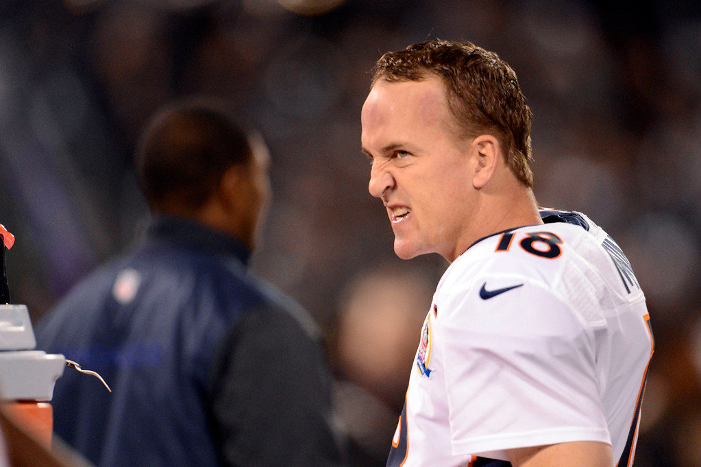 . Denver Broncos quarterback Peyton Manning (18) gets h9s game face on before kickoff against the Oakland Raiders Thursday, December 6, 2012 during Thursday Night Football at O.c Coliseum in Oakland  John Leyba, The Denver Post