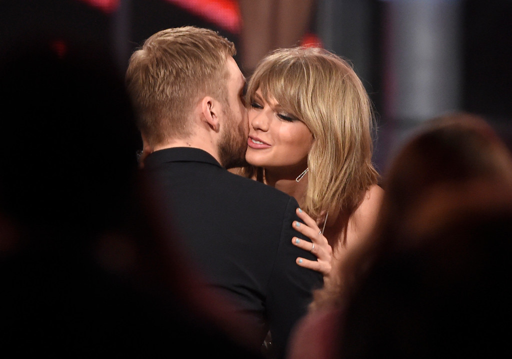 . Taylor Swift, right, hugs Calvin Harris after winning the award for top billboard 200 album for �1989� at the Billboard Music Awards at the MGM Grand Garden Arena on Sunday, May 17, 2015, in Las Vegas. (Photo by Chris Pizzello/Invision/AP)