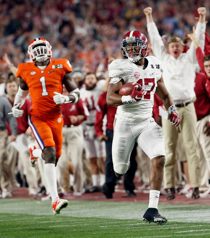 . Alabama\'s Kenyan Drake, right, breaks away for a touchdown return against Clemson\'s Jayron Kearse (1) during the second half of the NCAA college football playoff championship game Monday, Jan. 11, 2016, in Glendale, Ariz. (Michael Chow/The Arizona Republic via AP) MARICOPA COUNTY OUT; MAGS OUT; NO SALES; MANDATORY CREDIT