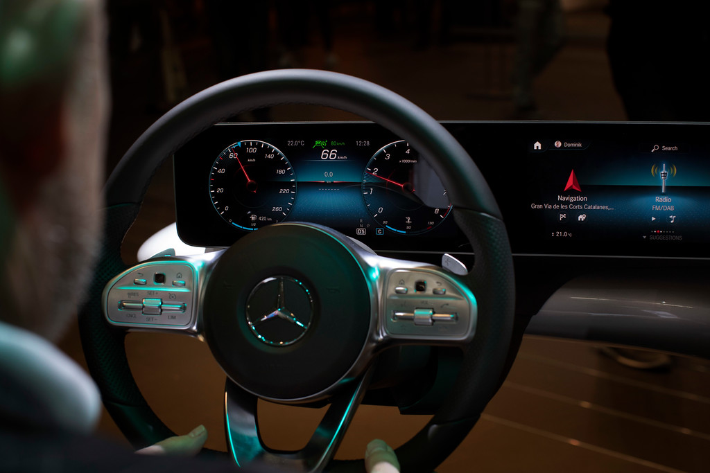 . A visitor looks at the latest Mercedes-Benz digitalized car, during the Mobile World Congress wireless show, in Barcelona, Spain, Monday, Feb 26, 2018. The annual Mobile World Congress (MWC) runs from 26 February - 1 March and draws over 2,300 exhibitors to Barcelona, including industry heavyweights Samsung, Huawei and Nokia. (AP Photo/Emilio Morenatti)