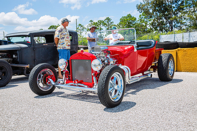 Car enthusiasts talk to Chuck West of Jupiter, owner of the 1923 Chevy T-Bucket  at Palm Beach International Raceway on Saturday, May 25, 2019. [JOSEPH FORZANO/palmbeachpost.com]