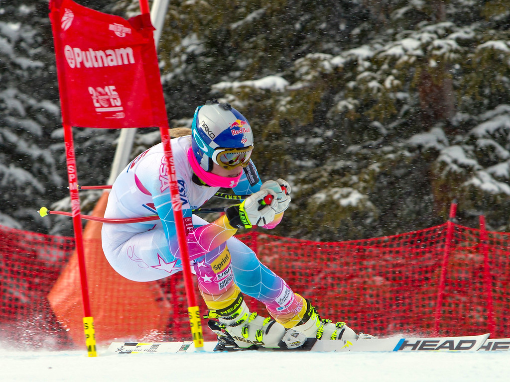 . Lindsey Vonn, of Vail, Colo., speeds past the 2015 World Championships ski racing gate at the U.S. Ski Team training center at Copper Mountain, Colo., on Wednesday, Nov. 6, 2013. (AP Photo/Nathan Bilow)