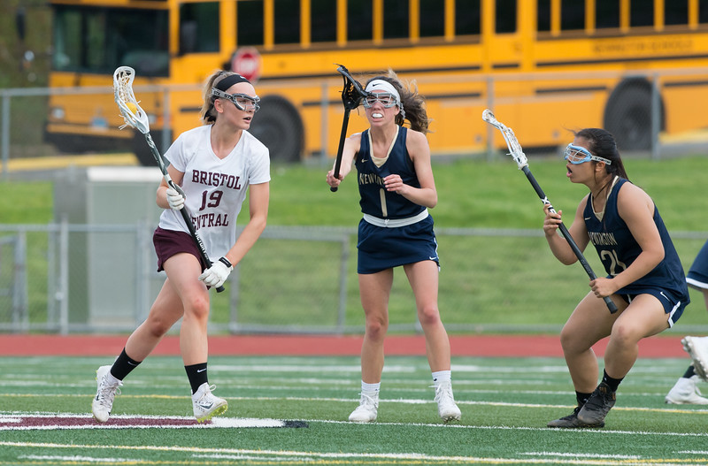 05/10/19  Wesley Bunnell | Staff  Newington girls lacrosse defeated Bristol Central in an away game at Bristol Central High School on Friday afternoon. BC's Lexi Michaud (19). Newington's Morgan Hellman (1) and Erin Stenvall (24).