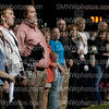 Senior Connan Brennon stands with his parents as his name gets announced for senior band night on Friday Sep.13 at SMN. During the football game band parents were riling up for there enterance.