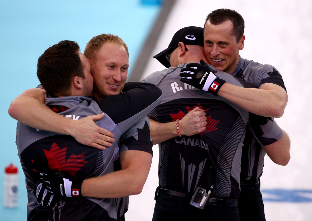 . Caleb Flaxey, Brad Jacobs, Ryan Harnden and EJ Harnden of Canada celebrate as they win gold during the Men\'s Gold Medal match between Canada and Great Britain on day 14 of the Sochi 2014 Winter Olympics at Ice Cube Curling Center on February 21, 2014 in Sochi, Russia.  (Photo by Clive Mason/Getty Images)