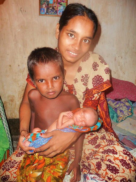 rukhia (our housekeeper), is also a midwife and helped give birth to this tiny baby.  this is the baby's mother and brother.