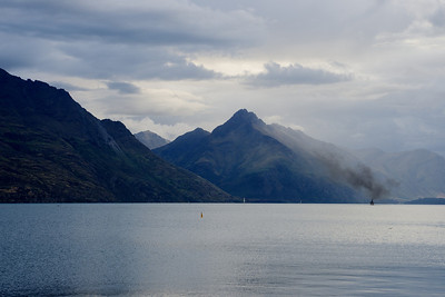 The smokey steamboat makes its way down Lake Wakatipu, Queensland, New Zealand.