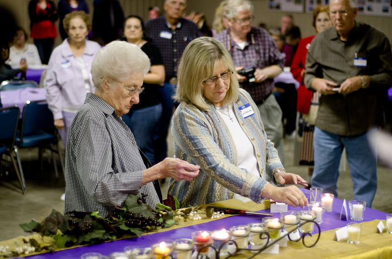 Martha Klodzinski and Susie Habegger Lighting the Memory Cnadle for Teofil Klodzinski