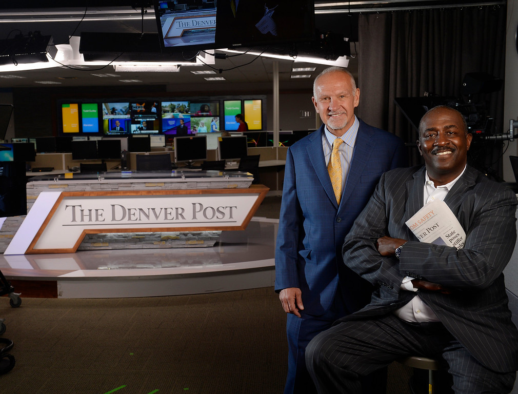 . DENVER, CO - OCTOBER 06: The Denver Post president and CEO Mac Tully, left, with Denver Post editor Greg Moore on the set for DPTV in the Post newsroom on Tuesday, October 06, 2015.  (Photo by Cyrus McCrimmon/The Denver Post )
