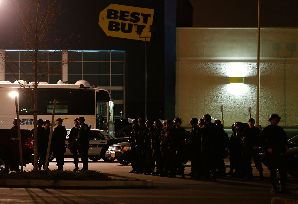 . WATERTOWN, MA - APRIL 19: Boston Police gather in the parking lot in front of a Best Buy store on April 19, 2013 near the Watertown Mall in Watertown, Massachusetts. (Photo by Jared Wickerham/Getty Images)