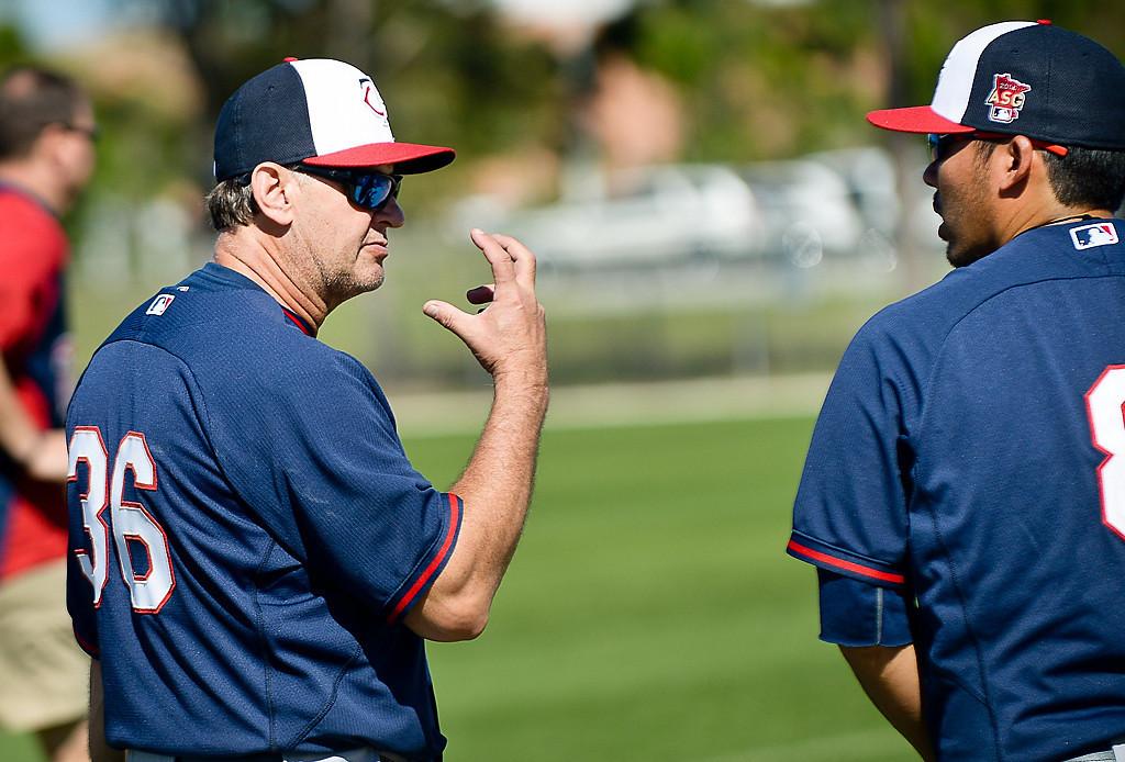 . Bench coach Terry Steinback, left, chats with new Twins catcher Kurt Suzuki outside Hammond Stadium. (Pioneer Press: Ben Garvin)