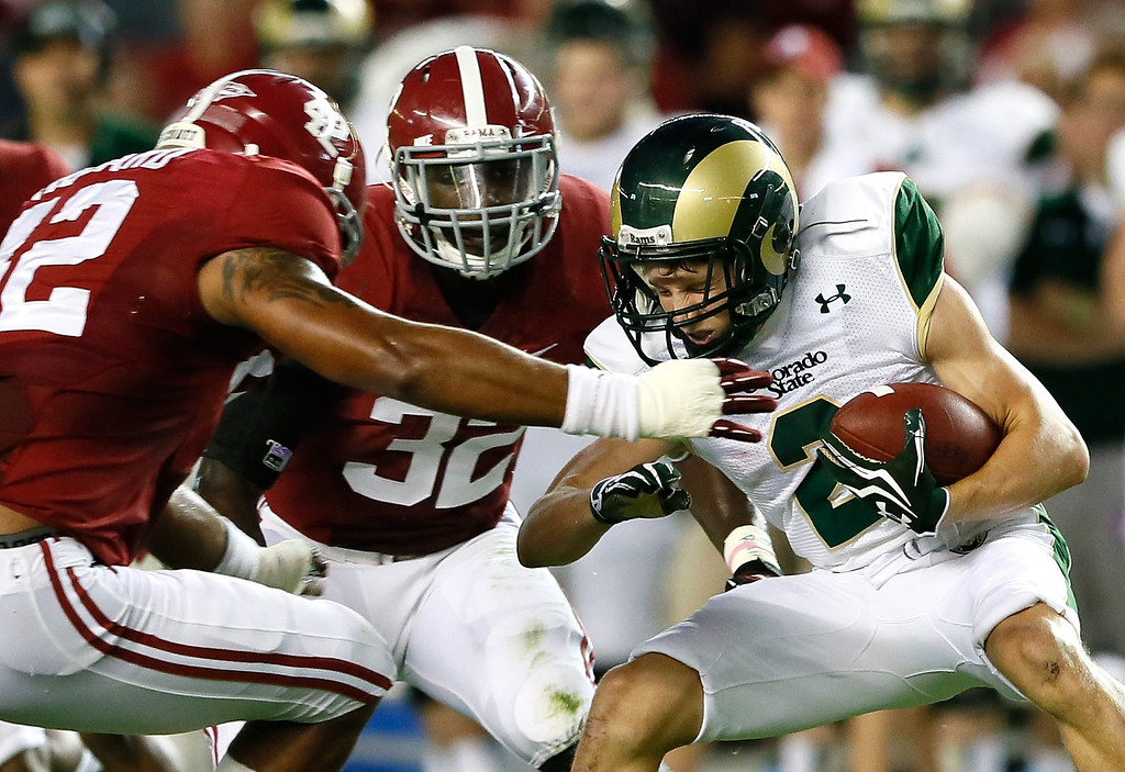 . TUSCALOOSA, AL - SEPTEMBER 21:  Thomas Coffman #2 of the Colorado State Rams braces for a tackle by Adrian Hubbard #42 of the Alabama Crimson Tide at Bryant-Denny Stadium on September 21, 2013 in Tuscaloosa, Alabama.  (Photo by Kevin C. Cox/Getty Images)