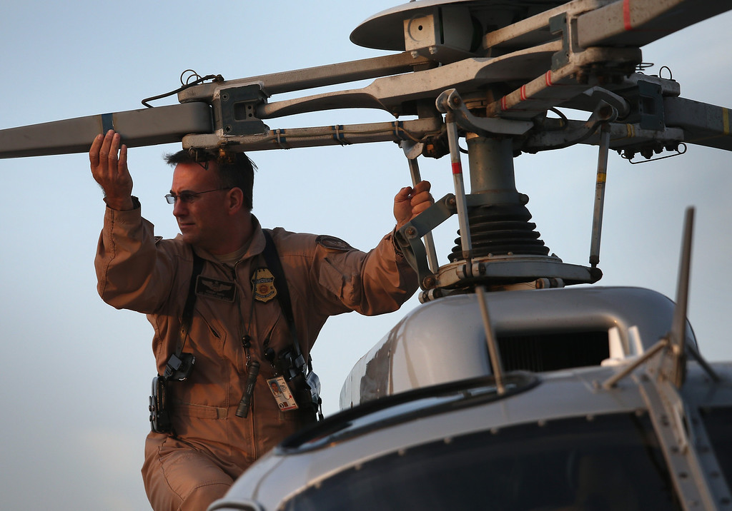 . McAllen, TX - APRIL 11:  U.S. Office of Air and Marine (OAM), pilot Rob Smith performs a pre-flight check on an Astar B-2 helicopter before flying a patrol along the U.S.-Mexico border on April 11, 2013 in McAllen, Texas. The OAM, which assists U.S. Border Patrol agents from the air in locating undocumented immigrants and drug smugglers, has cut back flights drastically due to federal sequestration budget cuts. According to the U.S. Border Patrol, undocumented immigrant crossings have increased more than 50 percent in Texas\' Rio Grande Valley sector in the last year. Border Patrol agents say they have also seen an additional surge in immigrant traffic since immigration reform negotiations began this year in Washington D.C. Proposed refoms could provide a path to citizenship for many of the estimated 11 million undocumented workers living in the United States.  (Photo by John Moore/Getty Images)