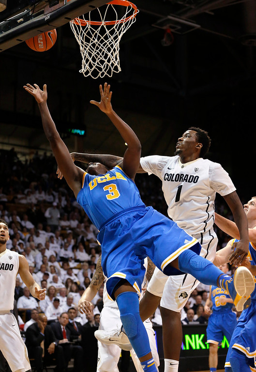 . UCLA\'s Jordan Adams (3)  is fouled by Colorado\'s Wesley Gordon during the first half of an NCAA college basketball game in Boulder, Colo., Thursday, Jan. 16, 2014. (AP Photo/Brennan Linsley)