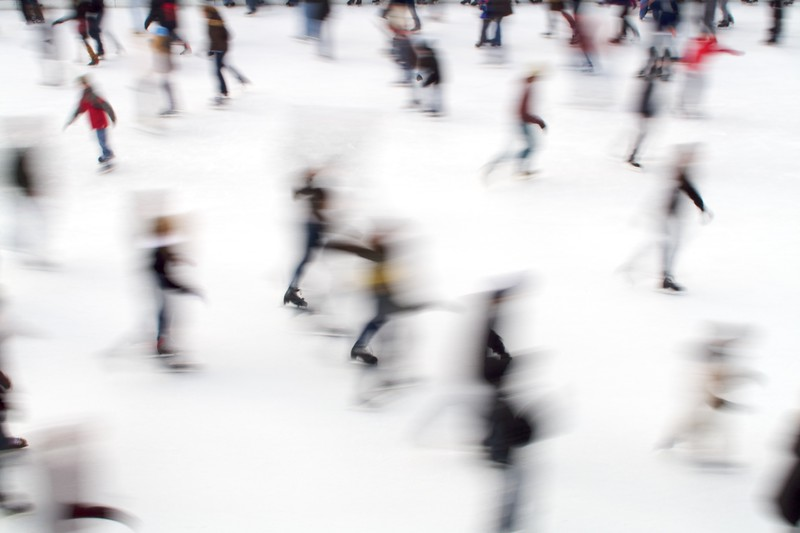 Ice skaters Millennium Park Chicago. Intentional blur.