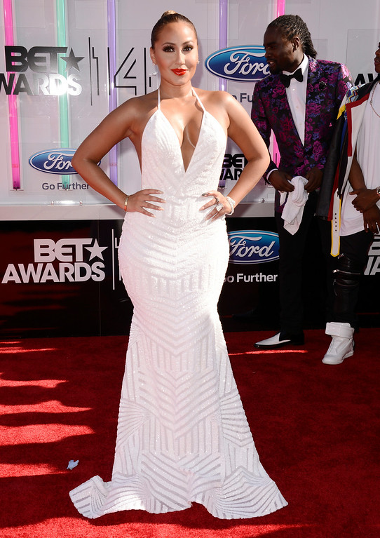 . Adrienne Bailon arrives at the BET Awards at the Nokia Theatre on Sunday, June 29, 2014, in Los Angeles. (Photo by Dan Steinberg/Invision/AP)