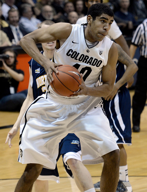 . University of Colorado\'s Josh Scott snags a rebound during a game against Northern Arizona on Friday, Dec. 21, at the Coors Event Center on the CU campus in Boulder.   (Jeremy Papasso/Daily Camera)