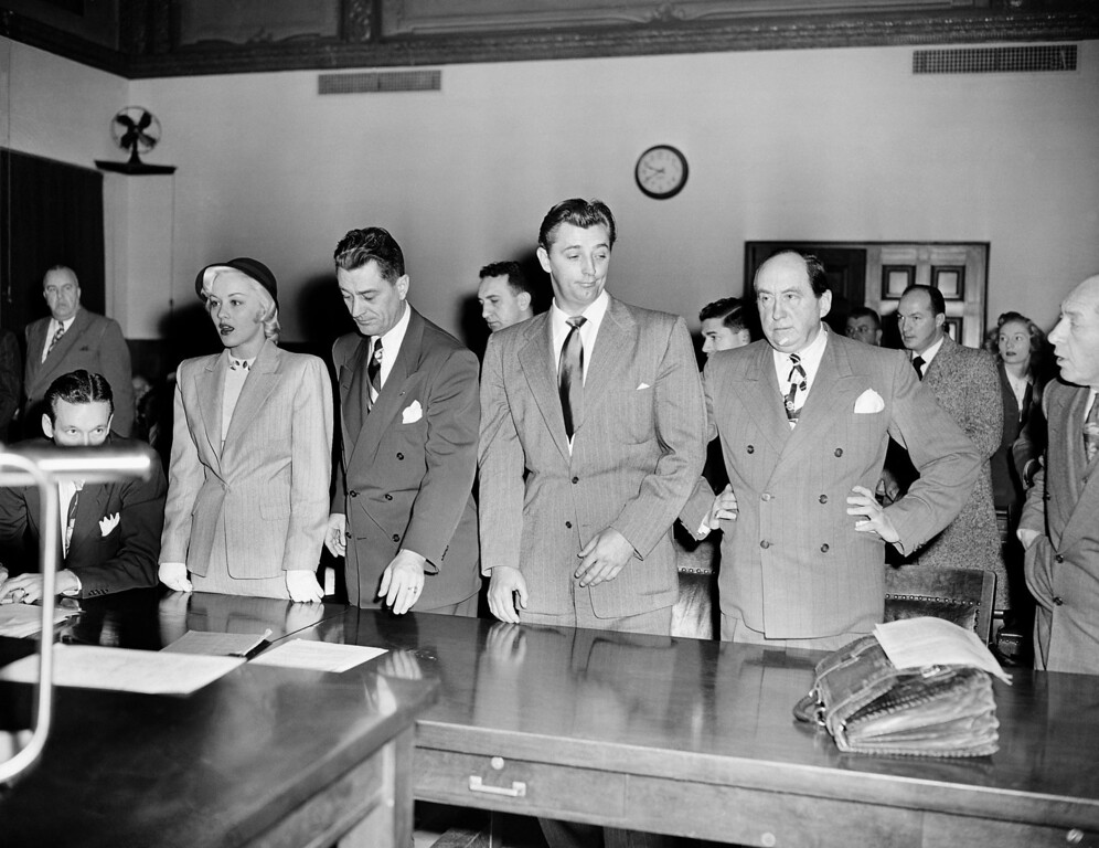 . This was the scene Feb. 9, 1949 in Los Angeles, a moment after Superior Court Judge Clement D. Nye sentenced actor Robert Mitchum and actress Lila Leeds to 60 days in jail on charges of conpiracy to possess Marijuana Cigarettes. (AP Photo)