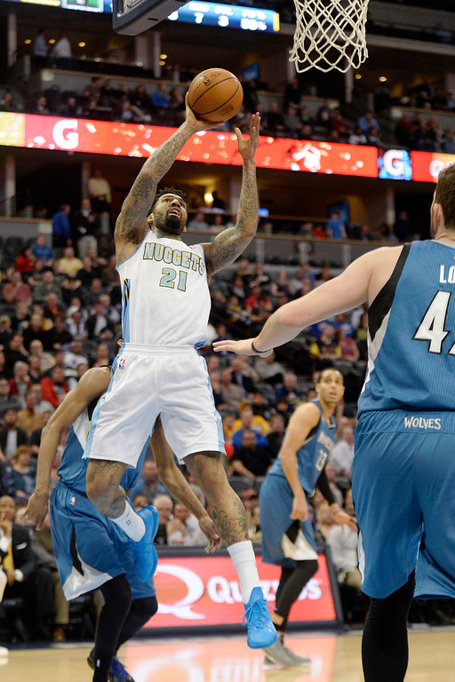 . Wilson Chandler (21) of the Denver Nuggets shoots against the Minnesota Timberwolves during the first quarter at the Pepsi Center.   (Photo By AAron Ontiveroz/The Denver Post)