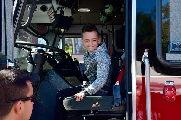 10/5/2019 Mike Orazzi | StaffrAbriel Marcano enjoys some time behind the wheel of a fire truck while at the 51st Annual Apple Harvest Festival in Southington on Saturday.
