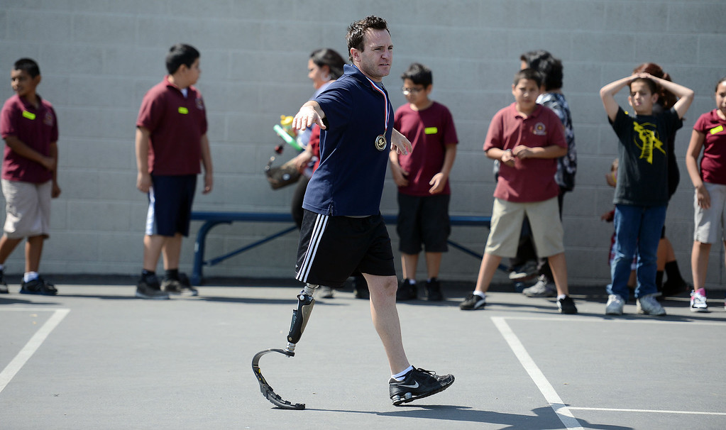 . Paralympian John Siciliano works with students at Korenstein Elementary School as part of  Ready, Set, Gold, a public-private partnership with the Southern California Committee for the Olympic Games that is designed to motivate children to set and reach their goals, primarily in health and fitness to help combat childhood obesity and diabetes. (Hans Gutknecht/Staff Photographer)