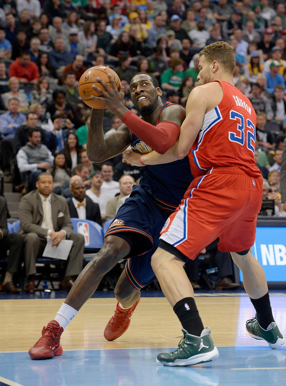 . Denver Nuggets center J.J. Hickson (7) drives on Los Angeles Clippers forward Blake Griffin (32) during the first quarter. (Photo by John Leyba/The Denver Post)